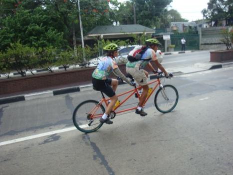 som erode using their tandem bike