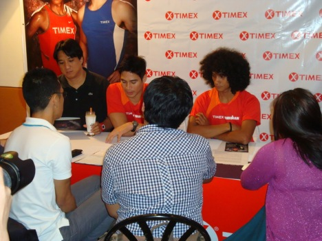 the duo being interviewed by the showbiz media