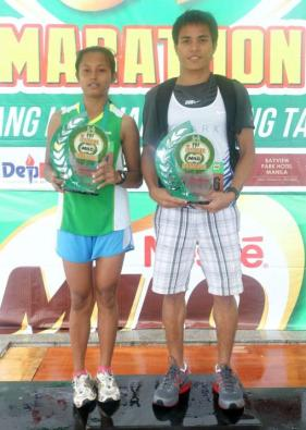 ric Panique and Stephanie Cadosale displayed determination and stamina that sustained them in the harsh and difficult weather all-throughout the 21-K race en route to bringing home the top purse at the Bacolod qualifiers of the 36th National MILO Marathon.