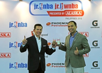 Wilfred Steven Uytengsu, Jr., President and CEO, Alaska Milk Corporation and Carlo Singson, NBA Asia Country Manager for the Philippines signify the official opening of the Jr. NB Alaska 2015 Season with an Alaska choco and milk toast