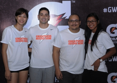 UAAP volleyball superstars Alyssa Valdez from the Ateneo Lady Eagles (rightmost), Mika Reyes from the De La Salle Lady Spikers (leftmost) and basketball hotshot Chris Banchero of the Alaska Aces , three of four of the newest Gatorade Ambassadors, pose for a photo with Pepsico Philippines Marketing Manager for Hydration Tony Atayde